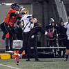 CARL RUSSO/Staff photo. Whittier's Robby Gramstorff (right) leaps into the air to break up this pass attended for Greater Lawrence's Joseph Pagan. The Whittier Wildcats defeated the Greater Lawrence Reggies 38-0 in Thanksgiving Eve football action. 11/27/2013.