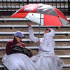 CARL RUSSO/Staff photo. Football fans attending the Whittier Tech. and Greater Lawrence football game tolerate the rain. The Whittier Wildcats defeated the Greater Lawrence Reggies 38-0 in Thanksgiving Eve football action. 11/27/2013.