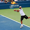 Marcos Baghdatis slamming a backhand down the line winner against Stanislas Wawrinka
