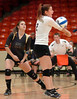 #2 for Rye Cove returns serve in front of teammate, #21. Photo by Ned Jilton II