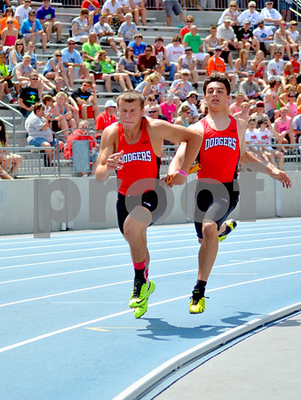 - Messenger photo by Britt Kudla       <br /> Fort Dodge's Keegan Jones (Left) and Austin Anderson competers in the 4x100 meter relay on Friday at Drake stadium