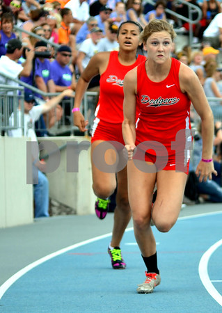 - Messenger photo by Britt Kudla       <br /> Fort Dodge's Lexi Astor (Right) and Ashley Altman competes in the 4x200 meter relay