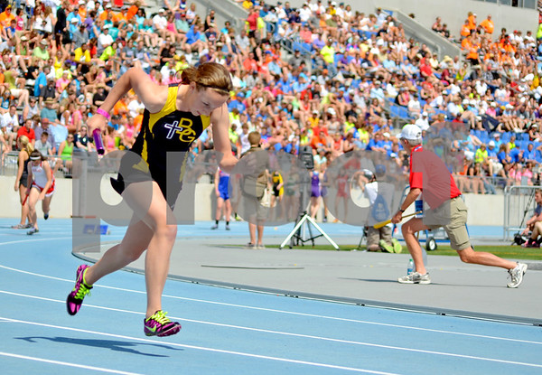 - Messenger photo by Britt Kudla       <br /> Bishop Garrigan's Taylor Frideces competes in the 4x200 meter relay on Friday