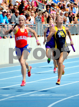 - Messenger photo by Britt Kudla       <br /> Bishop Garrigan's Nicole Behr crosses the finish line after running in the 4x200 meter relay