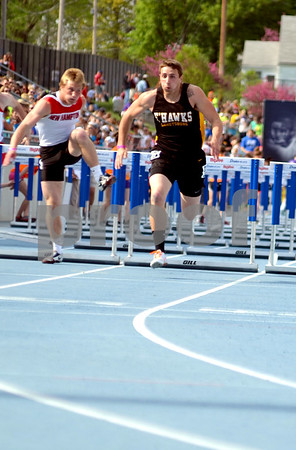 - Messenger photo by Britt Kudla       <br /> Emmetsburg's Cody Henderson competes in the 110 meter hurdle on Friday