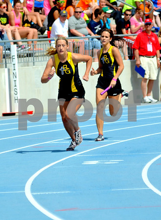 - Messenger photo by Britt Kudla       <br /> Bishop Garrigan's Chelsi Lanus (Left) and teammate Aisha Miller competes in the 4x200 meter relay of Friday