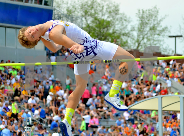 - Messenger photo by Britt Kudla       <br /> Eagle Grove's Brandon Johnson competes in the High Jump on Friday at Drake Stadium