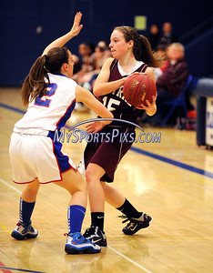 1/15/2013 Mike Orazzi | Staff Plainville High School's Kelley Slabinski (2) and Bristol Central's Allison Martel (15) at PHS on Tuesday night.