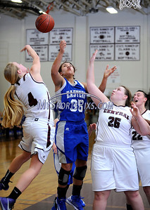 1/17/2013 Mike Orazzi | Staff Bristol Eastern's Karissa Smith (35) and Bristol Central's Lauren Bossi (4) and Gretchen Edelman  (25) during Thursday night's basketball game at BCHS.