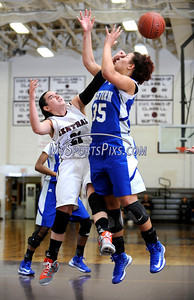 1/17/2013 Mike Orazzi | Staff Bristol Eastern's Karissa Smith (35) and Bristol Central's Erika Monsalve (21) during Thursday night's basketball game at BCHS.