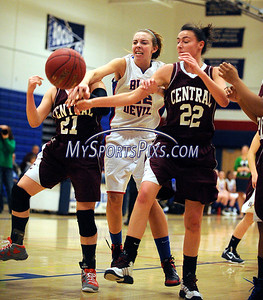 1/15/2013 Mike Orazzi | Staff Plainville High School's Kelsey Clemens (22) and Bristol Central's Erika Monsalve (21) and Christina Bouvier (22) at PHS on Tuesday night.