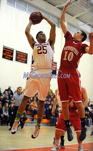 1/2/2013 Mike Orazzi | Staff Terryville's Arthur Trent (25) and Northwestern's John Stevens (10) at THS on Wednesday night.