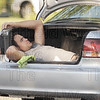 107 Man sleeping in car trunk