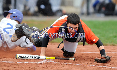 4/19/2013 Mike Orazzi | Staff Terryville's Ian Schmidt (2) dives for the throw as Lewis Mills' Zane Milbourn (27) scores at THS on Friday.