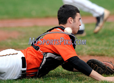 4/19/2013 Mike Orazzi | Staff Terryville's Ian Schmidt (2) dives for a fly ball against Lewis Mills at THS on Friday.