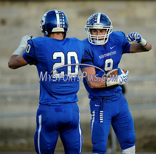 12/7/20123 Mike Orazzi | Staff Southington's Alexander Jamele (9) and Jasen Rose (20) celebrate Jamele's  TD during the CIAC 2013 Class LL Football semi-final at West Haven High School on Saturday. Southington won 45-0 and will play Fairfield Prep for the state title.