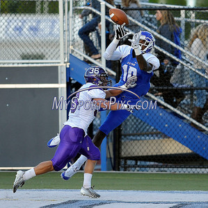 9/14/2013 Mike Orazzi | Staff CCSU's Denzell Jones (10) and Holy Cross' Ben Coffaro (36) in New Britain on Saturday.
