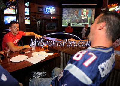 9/12/2013 Mike Orazzi | Staff Addison Fasolo talks with Matt  Reklaitis while watching the Jets and Patriots at City Sports Grille in Bristol on Thursday night.