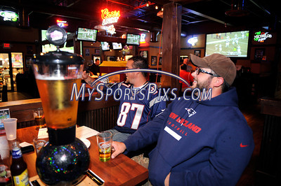 9/12/2013 Mike Orazzi | Staff Brothers Matt and Mike Reklaitis watch the Jets and Patriots at City Sports Grille in Bristol on Thursday night.