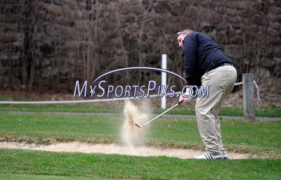 4/16/2013 Mike Orazzi | Staff Bristol Eastern's Ryan Cassin hits out of a bunker on Three during Tuesday's golf match with Berlin at the Chippanee Golf Club.