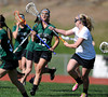 4/25/2013 Mike Orazzi | Staff<br /> Bristol girl's lacrosse's Shelby Folson (11) and Northwest Catholic's Lauren Bonk (19) at BEHS on Thursday afternoon.
