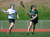 4/25/2013 Mike Orazzi | Staff<br /> Bristol girl's lacrosse's Jamie Guelli (14) and Northwest Catholic's Lauren Cenci (26) at BEHS on Thursday afternoon.