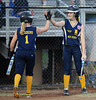 7/26/2013 Mike Orazzi   Staff<br /> New Jersey's McKenzie Medders (1) and Alexa Petito (13) celebrate a run during an 11-0 Jersey win over New York  in the 2013 Little League Softball Eastern Regional final at Breen Field on Friday night.