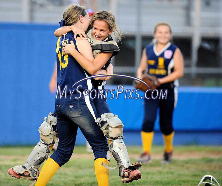 7/26/2013 Mike Orazzi | Staff<br /> New Jersey's Shea Walsh (5)  and Alexa Petito (13) celebrate after an 11-0 Jersey win over New York  in the 2013 Little League Softball Eastern Regional final at Breen Field on Friday night.