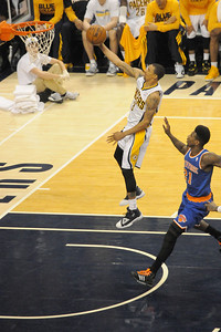 George Hill drives through the Knicks defense for a layup.
