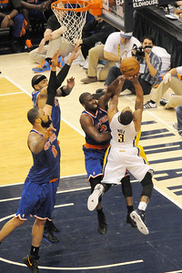 George Hill is fouled by Ray Felton.