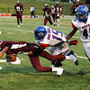 Central's Carnell Seals, 5, runs the ball for a short gain while West Brook's Devin Padia, 15, makes the tackle with Dominique Siemein, 45, coming in to assist at the Carroll Thomas Stadium Friday night. Photo provided by Drew Loker.