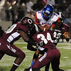 Central players close work to gether to bring down West Brook's Keith Corbin, 11, at the Carroll Thomas Stadium Friday night. Photo provided by Drew Loker.