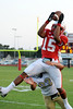 Bridge City's  Malcom Busby, 15, jumps for the reception with Kelly's Sean Bebeau, 23, there for the tackle at Bridge City Stadium Friday night. Photo provided by Drew Loker.