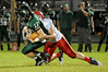 East Chambers' Brandon Johnson pulled down by Hardin-Jefferson player at Buccaneer Stadium Friday night. Photo provided by Drew Loker.