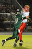 East Chambers' Landon Prejean, 48, puts the pressure on Hardin-Jefferson's Camden DuBois, 8, to force an interception at Buccaneer Stadium Friday night. Photo provided by Drew Loker.