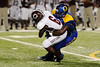 Ozen's Myles Mouton, 6, pulls down Central's Damon Thomas, 6, at the Carroll Thomas Stadium Friday night. Photo by Drew Loker.