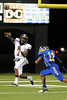 Central's Jacquet Michael, 7, tosses it away under pressure from Ozen's Teyard Polk, 12, at the Carroll Thomas Stadium Friday night. Photo by Drew Loker.