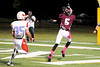 Central's Carnell Seals, 5,  sets up for a reception just beyond Lumberton's Taylor Miller, 35, at the Carroll Thomas Stadium Friday night. Photo by Drew Loker.