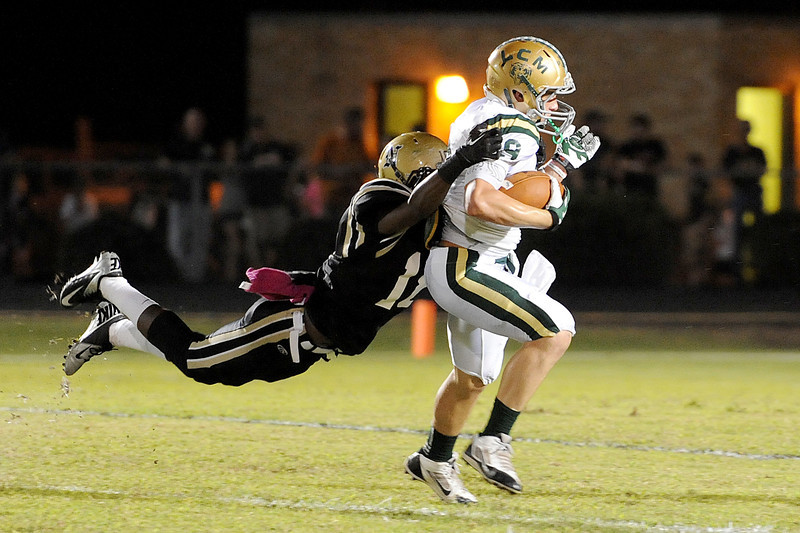 Nederland Bulldog's Shane Benoit, 11, tries to bring down LC-M Bear's Dalton Doyle, 9, after a nice completion and run at Bulldog Stadium Friday night. Photo by Drew Loker.