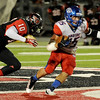 Memorial's Brandon Lumpkin, 10, moves in to tackle West Brook's Devin Padia, 10, at Memorial High School Stadium Friday night. Photo by Drew Loker.