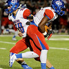 West Brook's Justin Hervey, 25, takes a hand off from Justin Essex, 10, at Memorial High School Stadium Friday night. Photo by Drew Loker.