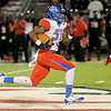 West Brook's Justin Hervey, 25, flys through the air on a 60 yard run resulting in a touch down at Memorial High School Stadium Friday night. Photo by Drew Loker.