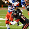 West Brook's Justin Hervey, 25, trys to avoid a tackle from Memorial's Morgan Ford, 13, at Memorial High School Stadium Friday night. Photo by Drew Loker.