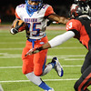West Brook's Justin Hervey, 25, looks for an opening at Memorial High School Stadium Friday night. Photo by Drew Loker.