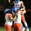 West Brook's Justin Hervey, 25, celebrates with teammates after a 60 yard scoring run at Memorial High School Stadium Friday night. Photo by Drew Loker.