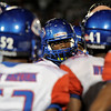 West Brook Bruins gather around during a time out at Memorial High School Stadium Friday night. Photo by Drew Loker.
