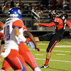 West Brook blocks a kick in the first quater at Memorial High School Stadium Friday night. Photo by Drew Loker.
