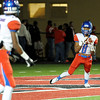 West Brook's Isiah Wilkerson, 8, looks to his teammate before deciding to return a kickoff at Memorial High School Stadium Friday night. Photo by Drew Loker.