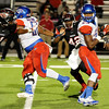 West Brook's Justin Hervey, 25, catches a short pass and turns to run for a short gain at Memorial High School Stadium Friday night. Photo by Drew Loker.