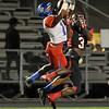 West Brook & Memorial players jump for a long pass intended for Memorial's Torian Lott, 3, at Memorial High School Stadium Friday night. Photo by Drew Loker.